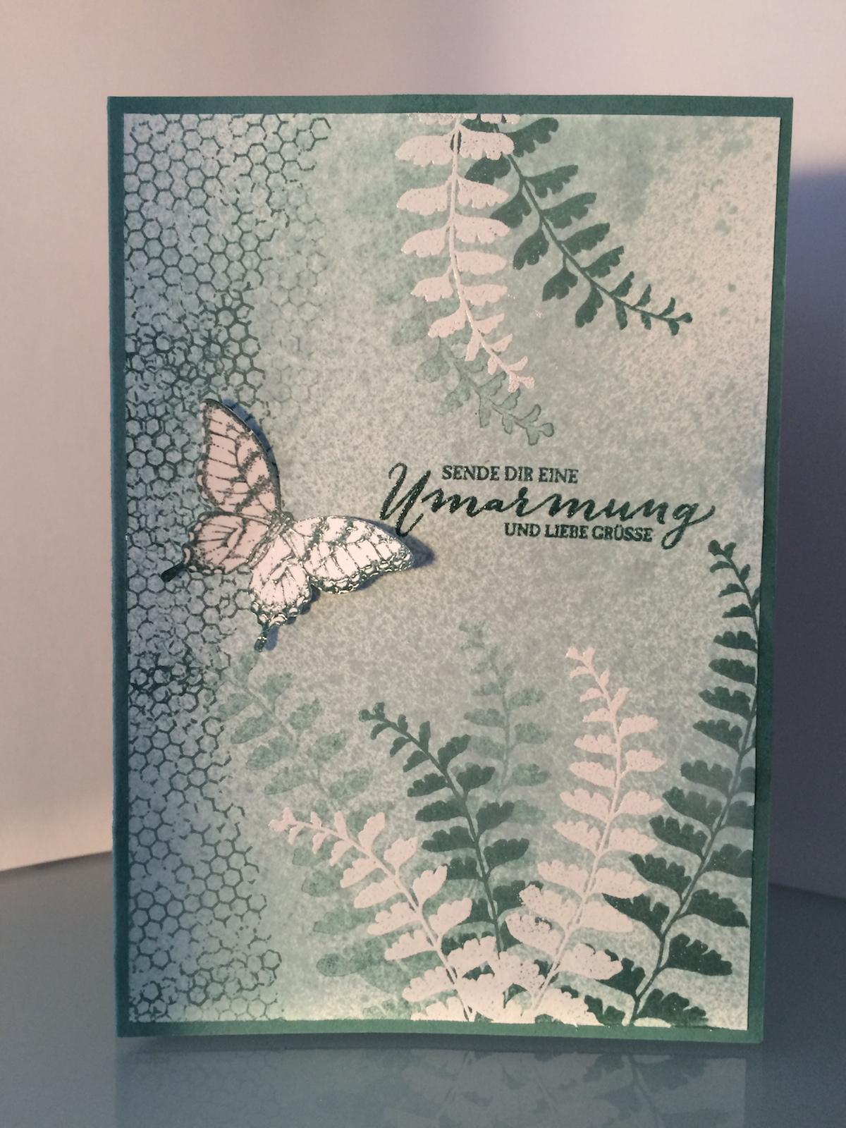 Karte Schmetterlingsgruß in Lagunenblau.